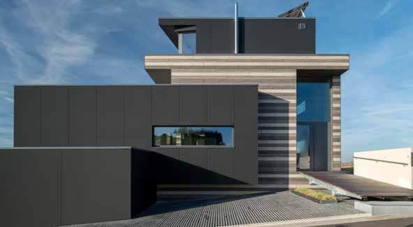 Maison facades bardage bois panneaux composite trespa for Bardage maison composite